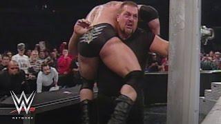 WWE Network: Big Show chokeslams Brock Lesnar through the announce table: SmackDown, Oct. 31, 2002