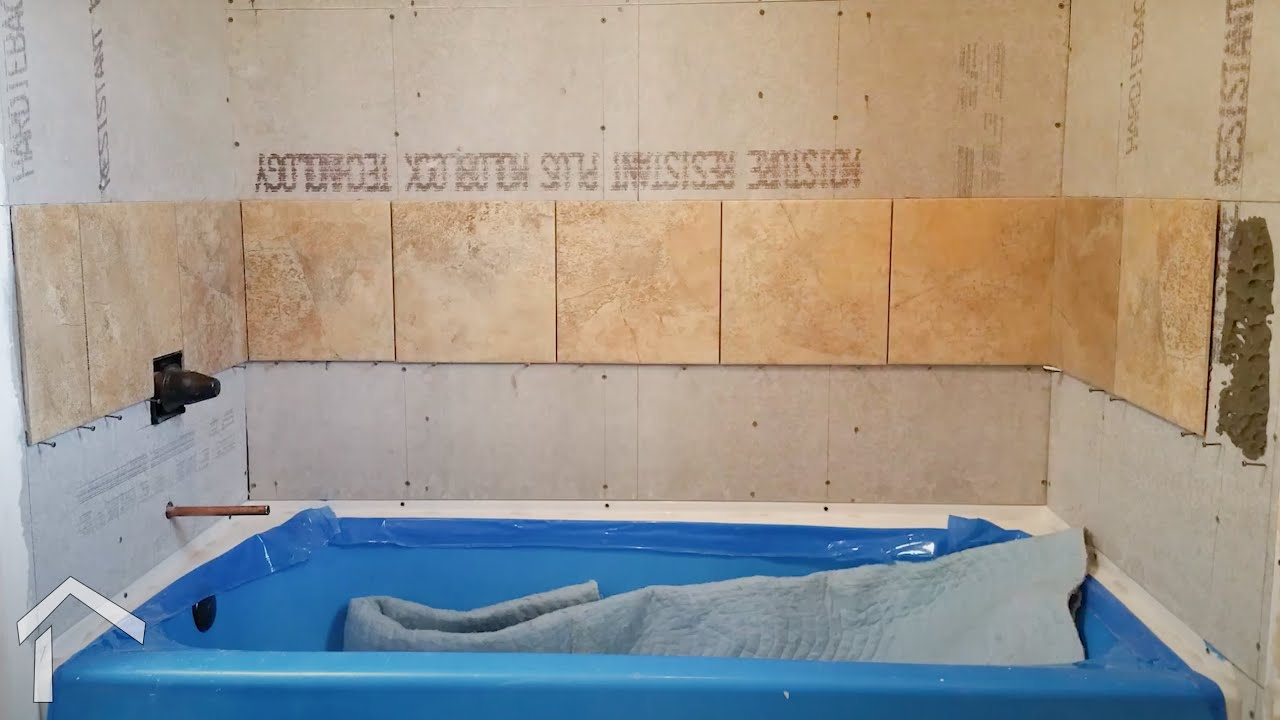 Setting Large Tile In Tub Surround - YouTube