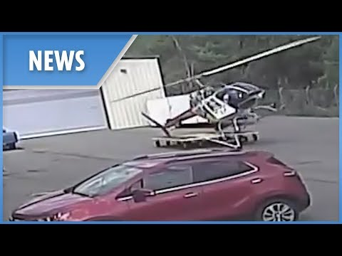 Police helicopter spectacularly CRASHES during takeoff