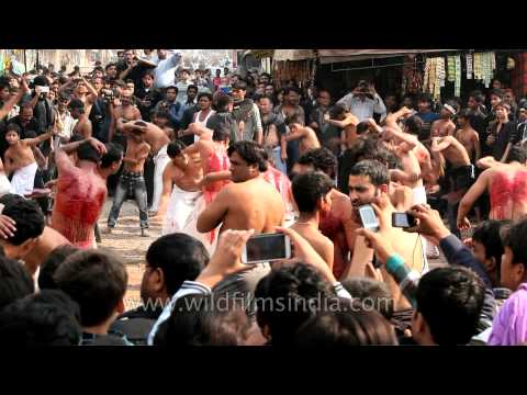 Shia muslims remembering the blood of Hussein at Muharram