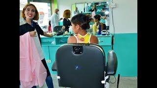 Girl in the barber chair