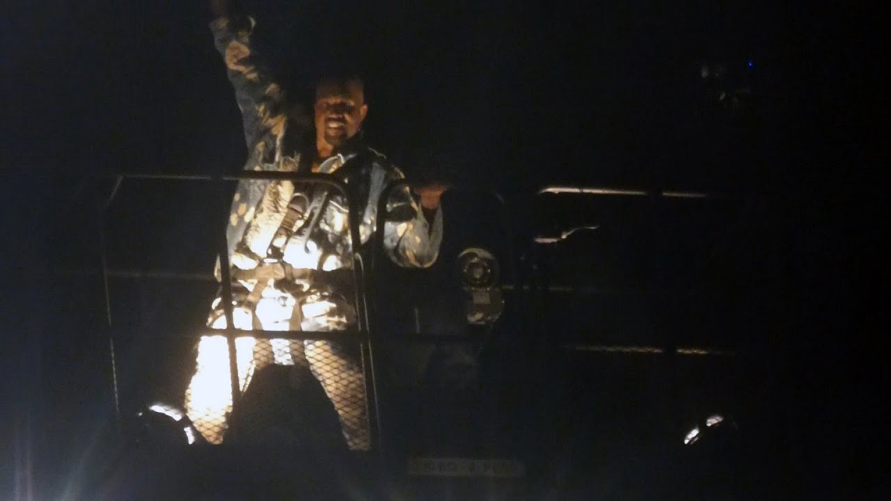 Kanye West performing from crane at Glastonbury Touch The