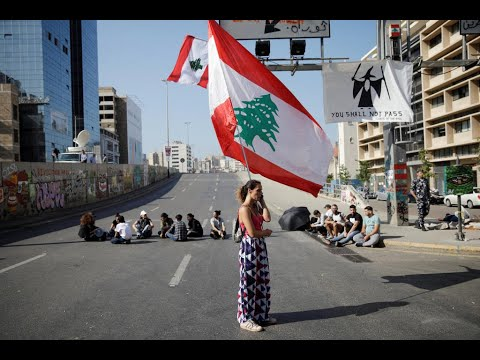 Lebanese protesters block roads in bid to oust political elite