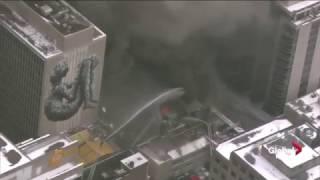 Toronto fire crews use ladder hoses to extinguish massive blaze