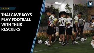 Thai cave boys play football with their rescuers