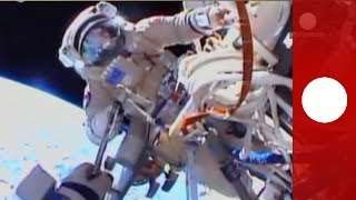 Spacewalk POV: Cosmonauts at work 400 km above Earth at ISS