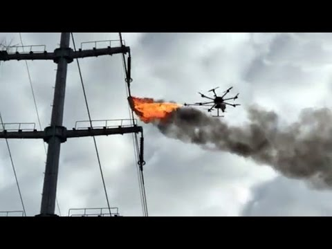Flame throwing drone clearing power line in China