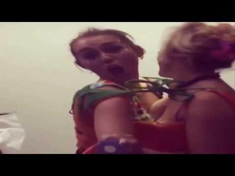 Miley Cyrus and Katy Weaver kissing