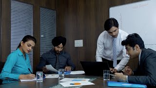 Young team leader discussing business related ideas with his colleagues - Corporate office atmosphere