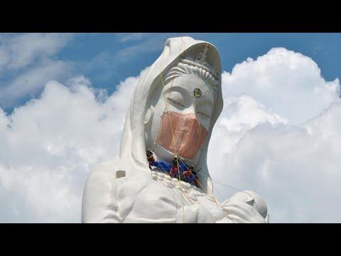 Giant Buddhist goddess gets face mask