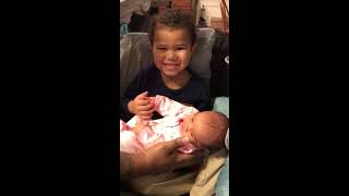 Toddler Boy Holds Baby Sister for the First Time 1045835