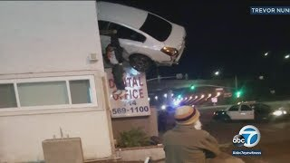 Car flies into 2nd story of Orange County building | ABC7