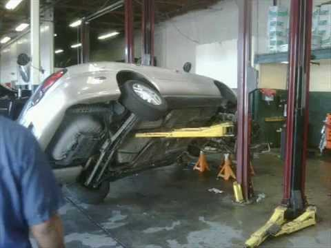 Car Falls Off Lift Youtube