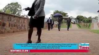 President Kagame and first lady in the rain at Kigali Genocide Memorial