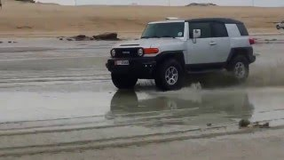 Nissan Patrol and FJ drifting on Yas Island Beach Abu Dhabi.