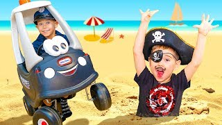 Toy car help to pull Pirate out of the sand on the sea 0+