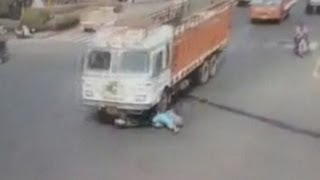 Dramatic crash: Trucks runs over woman on scooter