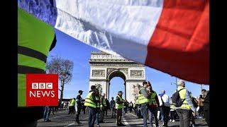 'Yellow-vests' pelt police van with stones - BBC News