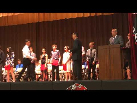 Certificates presented at Orion Middle School eighth grade promotion
