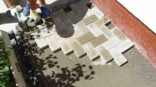 Montare pavele pe trotuar cu pat de nisip