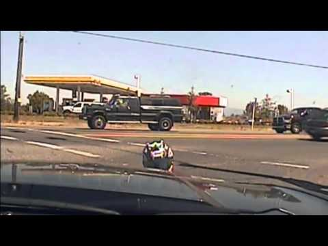 cop kicks biker