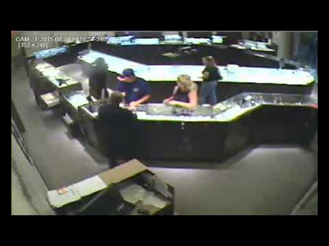 RAW: Surveillance camera captures smash-and-grab jewelry store robbery at Park Meadows Mall