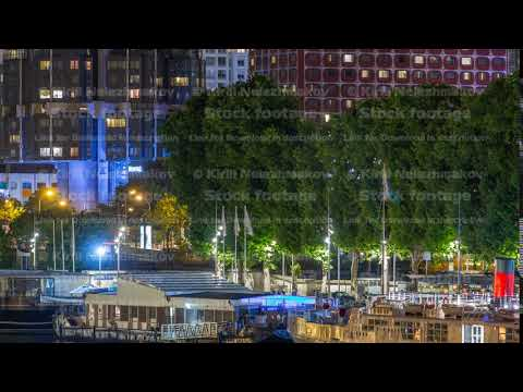 Seine river with ship in Paris at night timelapse, waterfront of the seine river in the city of