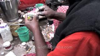 Denture being prepared by roadside dentist- Varanasi