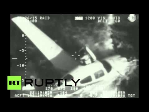CCTV: Plane parachutes into ocean after running out of fuel, pilot survives