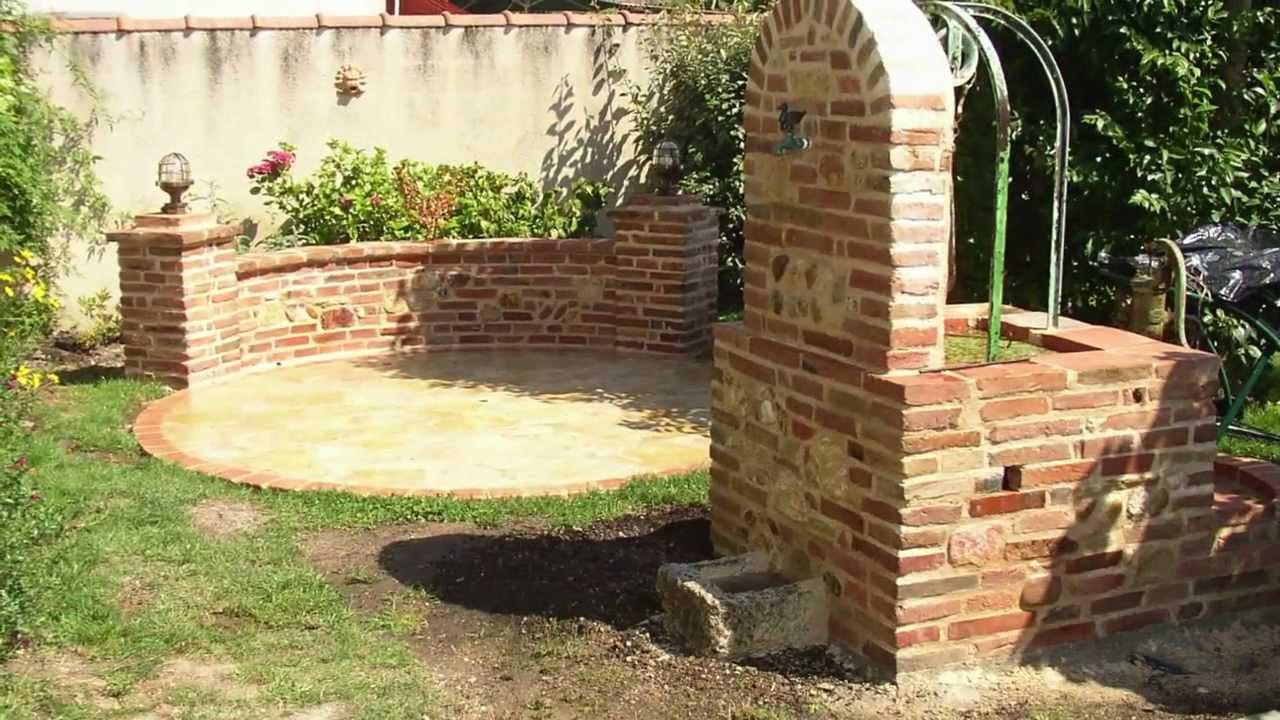 habillage d un puits et construction d une terrasse