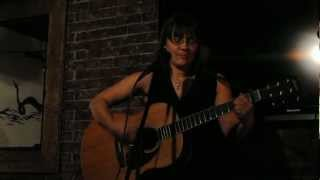 "Amy Girard singer/songwriter and poet singing her song ""Reeling """