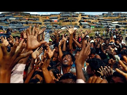 Hungry Rohingya refugees rush for handouts at Bangladesh camp