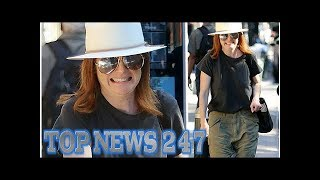 Julianne Moore goes casual in green frayed fatigue pants in New York