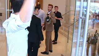 david beckham and his son brooklyn getting out of the balthazar restaurant then arguing with paps