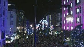 Robbie Williams switches on the Oxford Street Christmas lights