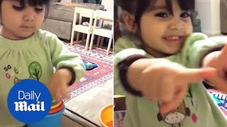 Adorable girl gets super-excited as she solves a puzzle