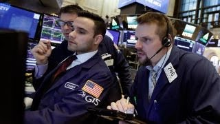 Stocks pull back from record highs