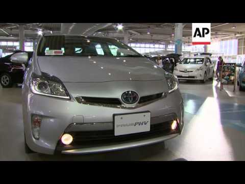 Toyota said Wednesday it is recalling 1.9 million hybrid Prius cars globally for a software glitch t
