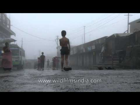 Cherrapunji - Children playing a game of football in the rain