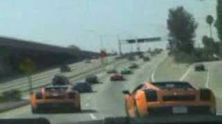 Lambos and exotics out for a cruise thru Los Angeles, including dow...
