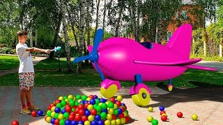 Alena and Pasha play with color balls