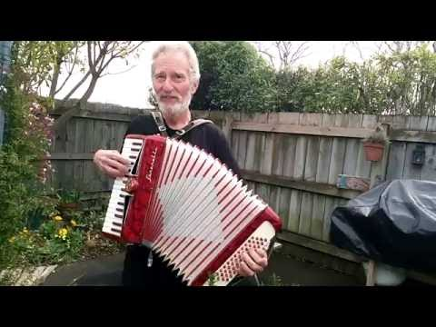 man play awesome accordion. spanish style music.