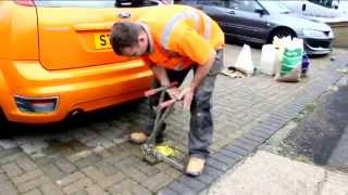 How to install a telescopic security post onto a block paved domestic driveway.
