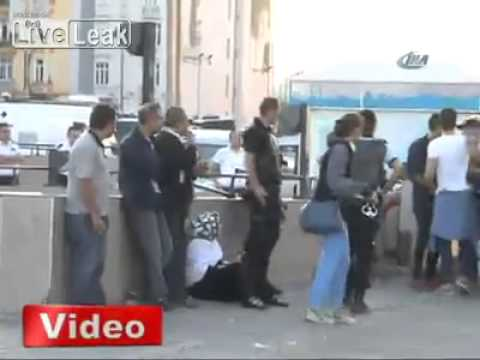Turkish police officer hit protesters