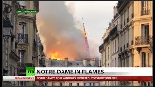 Watch Notre Dame spire collapse