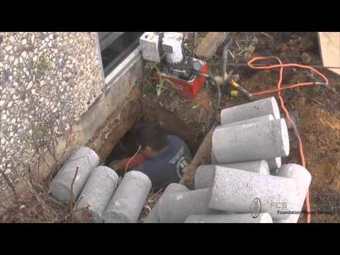 Foundation repair double press concrete piers