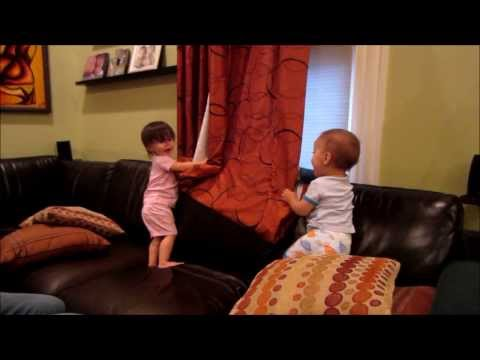 Kids playing curtain peek a boo