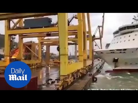 Out-of-control ferry CRASHES into huge crane causing FIRE!