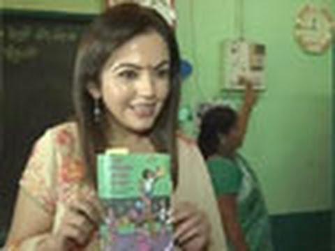 Nita Ambani teaches students at a Mumbai school
