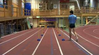 Stefan Holm jumps hurdles